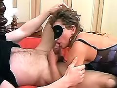 Mature lovers play sex game on bed