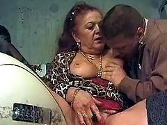 Young guy gives granny cunt massage
