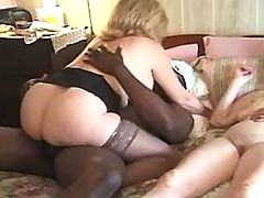 Two horny sluts get cumload in orgy