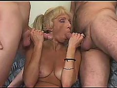 Two men have fun with blonde mature
