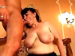 Busty mature has fun with two guys