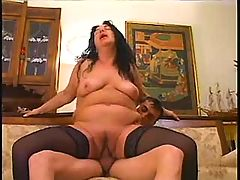 Mature sucks cock and fucks on sofa