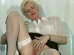 Mature blonde shows off her pussy